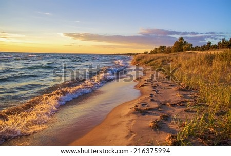 Beach Background. Beautiful sandy beach stretches to the blue sky horizon. - stock photo