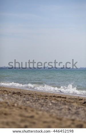 beach background, wave of blue sea on sandy beach soft and selective focus