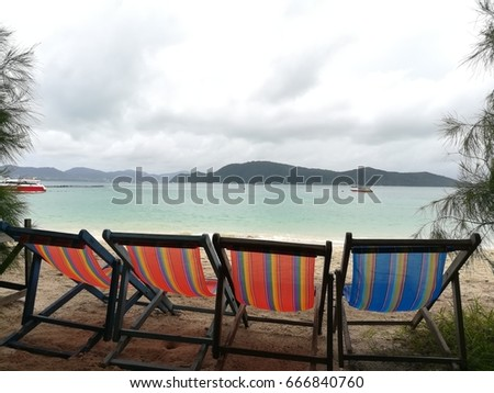 beach background with colorful beach bed on sand image for relex concept
