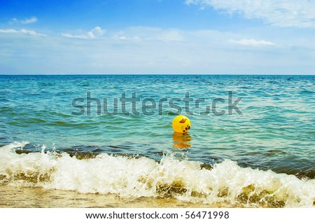 Beach ball adrift at sea