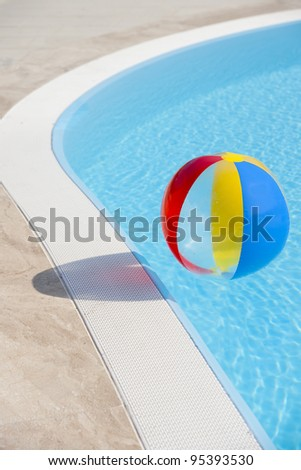 Beach ball on swimming-pool - stock photo