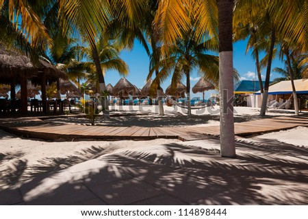 Beach bar in the Caribbean, under the palm trees - stock photo