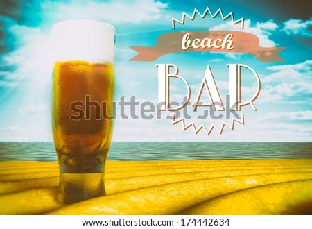 Beach bar sign with beer glass on sand - stock photo