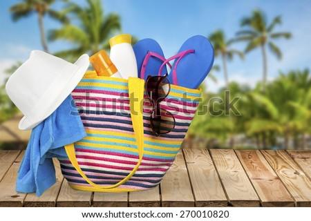 Beach. Beach bag with leisure items - stock photo