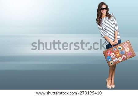 Beach. Beautiful blonde girl with her luggage on a beach - stock photo