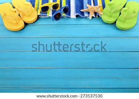 Beach border summer vacation background, sunglasses, flip flops, copy space. - stock photo