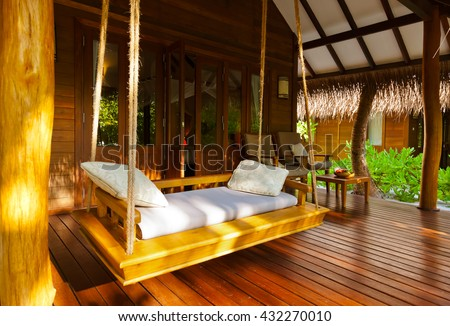Beach bungalow - Maldives vacation background - stock photo