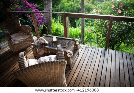 Beach bungalow terrace surrounded by jungle