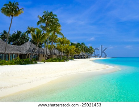Beach bungalows on a tropical island, travel background - stock photo