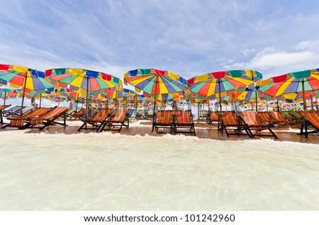 Beach chair and colorful umbrella on the beach in sunny day , Phuket Thailand - stock photo