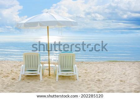 Beach Chair And Umbrella On Sand Beach