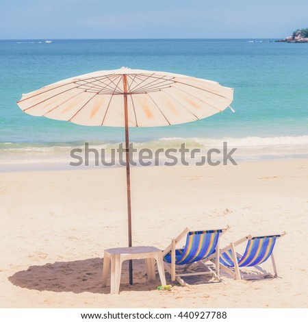 Beach chair and Umbrella on the beach at Samed Island,Thailand (Vintage filter effect used)