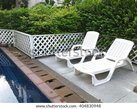 Beach chair at swimming pool - stock photo