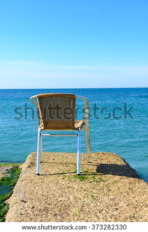 Beach chair in sunny day. Mediterranean sea. - stock photo