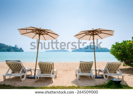 Beach chair in the Phuket Thailand beach - stock photo
