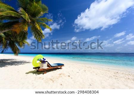 Beach chair on perfect tropical white sand beach - stock photo