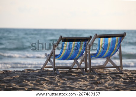 Beach chair on sand beach. Concept for rest, relaxation, holidays, spa, resort.