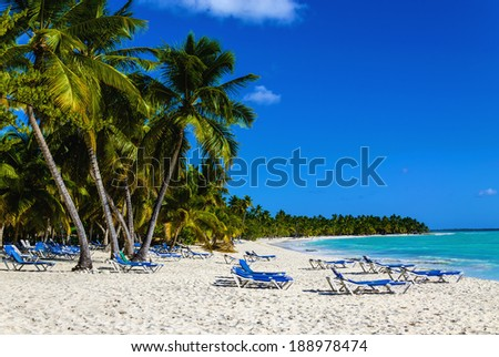 Beach chair on sandy Caribbean beach in Cuba. Concept for rest, relaxation, holidays, resort. - stock photo