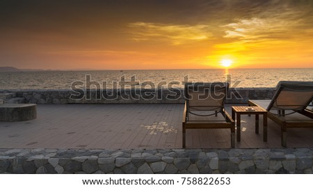 Beach chair on the beautiful sunset