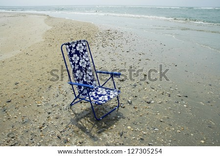 Beach Chair sitting on beach, room for your text - stock photo
