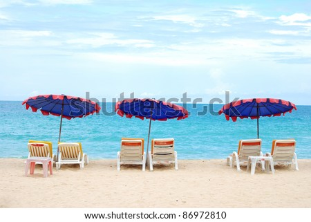 Beach chair. Sunbathing on the beach at the resort during the summer season looks - stock photo