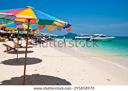 Beach chair under the umbrella of colorful on the beach Phuket, Thailand - stock photo