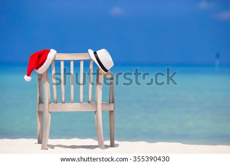 Beach chair with Christmas and straw hat background beautiful turquoise sea  - stock photo