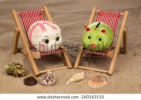 beach chair with piggy bank on the sandy beach. symbolic photo for cost of travel, vacation, holidays. save on vacation - stock photo