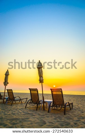 Beach chair with sunrise on twilight time - vintage filter