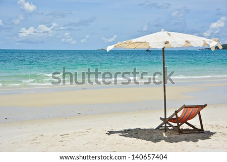 Beach chair with umbrella on the beach