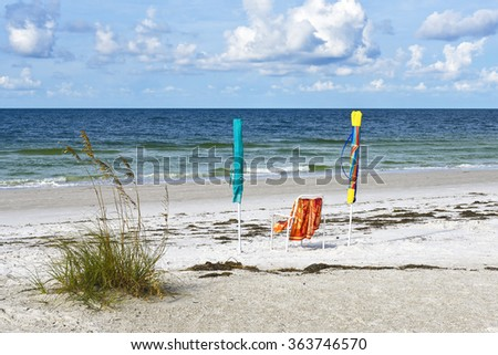 Beach Chair with Umbrellas on the Beach - stock photo