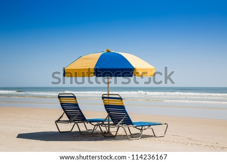Beach Chairs and Umbrella on an Empty Ocean Beach in Florida