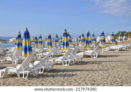 Beach chairs and umbrellas on the beach  - stock photo