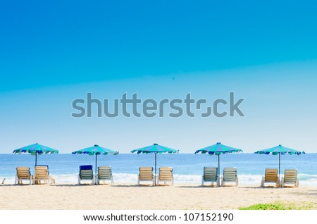 Beach chairs and with umbrella on the beach - stock photo