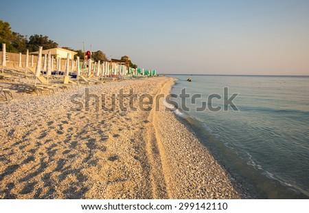 Beach chairs and with umbrella on the Portonovo beach in the marche region, Conero - Italy. - stock photo