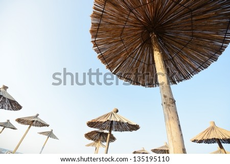 Beach chairs and with umbrella with copy space - stock photo