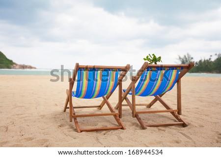 Beach chairs at sea front, Koh Phangan, Thailand - stock photo