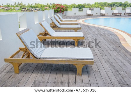beach chairs by the pool