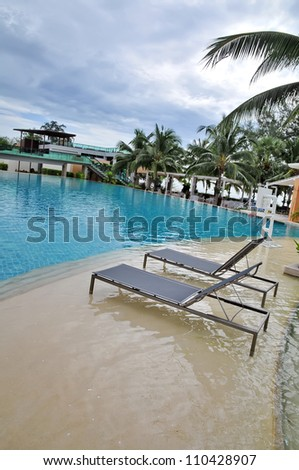Beach chairs in swimming pool