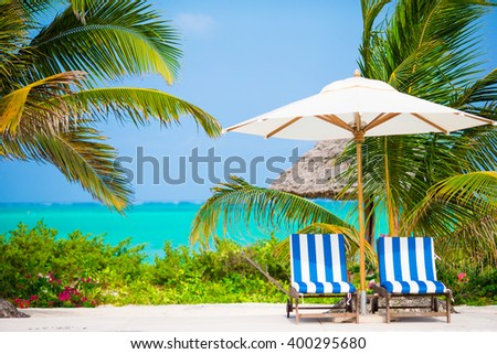 Beach chairs on exotic tropical resort - stock photo