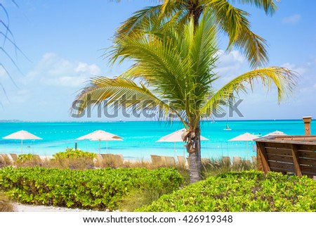 Beach chairs on exotic tropical white sandy beach - stock photo