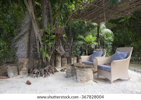 Beach chairs on round island Seychelles - stock photo