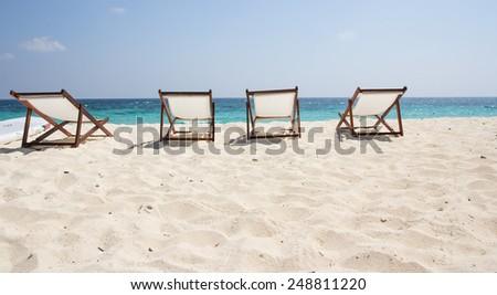 Beach chairs on sand beach - stock photo