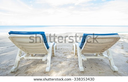 Beach chairs on the beach. Back view