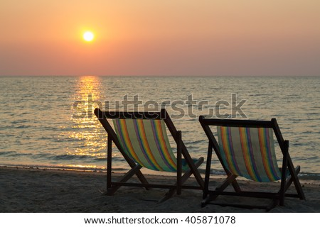 Beach chairs on the beach with sunset,twilight - stock photo