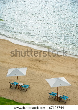 Beach chairs on the sand - stock photo