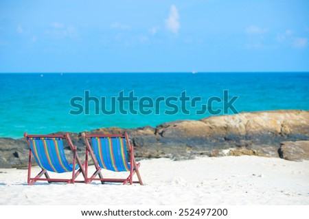 Beach chairs on the white sand beach Koh Samet, rayong province, Thailand - stock photo