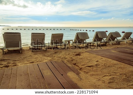 Beach Chairs With Sea View At Sunset - stock photo