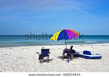 Beach Chairs with Umbrella and Raft on the Beach of Anna Maria Island, Florida