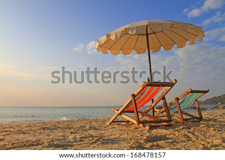 Beach chairs with umbrella at morning, samed island,thailand